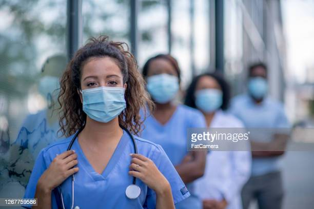 group of doctors outside - fatcamera stock pictures, royalty-free photos & images
