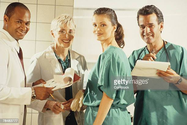 group of doctors - 20th century stock pictures, royalty-free photos & images