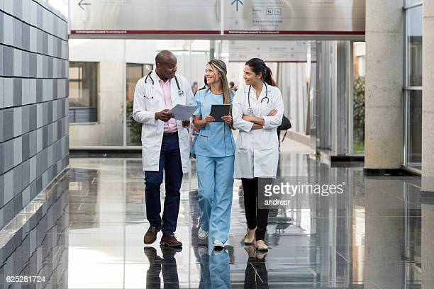 Group of doctors talking at the hospital