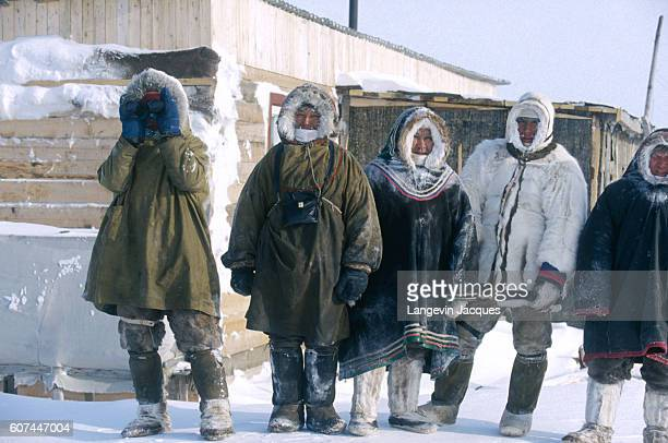 A group of Dolgans stand together at their camp near the village of Syndassko Russia The Dolgans traditionally a nomadic people who live along the...