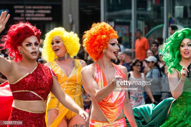 group of drag queen participants of lgbtq pride parade in montreal. - drag queen stock pictures, royalty-free photos & images