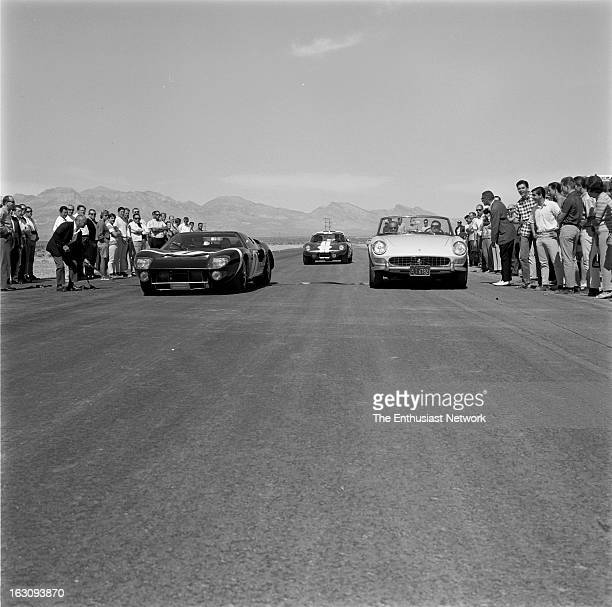 A group of drivers and racing dignitaries come out to the 1965 Grand Opening of the Stardust International Raceway in Las Vegas Nevada with Carroll...