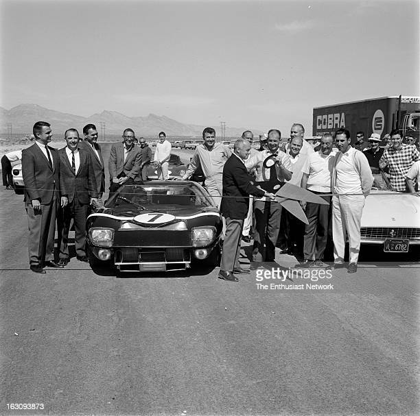 Group of drivers and racing dignitaries come out to the 1965 Grand Opening of the Stardust International Raceway in Las Vegas, Nevada, with Carroll...