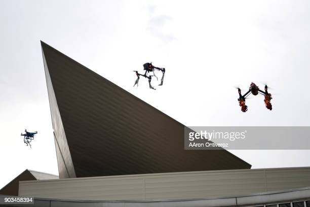 A group of drone pilots perform during the groundbreaking ceremony for the north addition to the Denver Art Museum on Wednesday January 10 2018