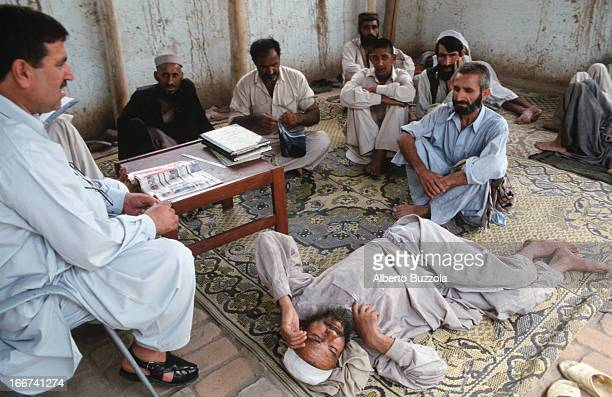 A group of drug addicts listen to a lecture on drug addiction inside the Hayatabad rehabilitation centre run by volunteers and former drug addicts...