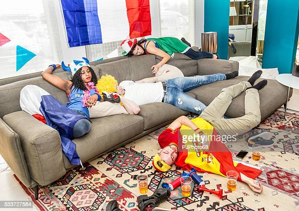 Group of drunk supporters at home