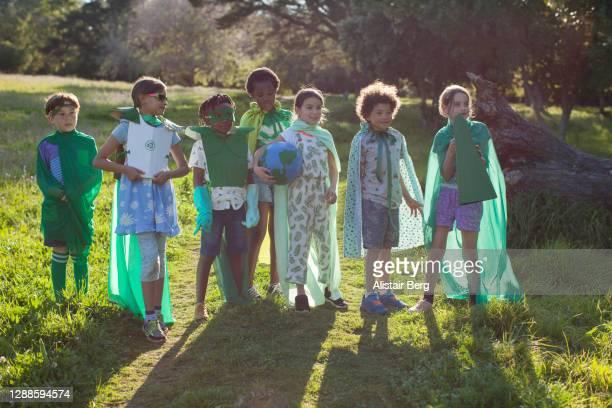 group of eco warrior children together in nature - activista fotografías e imágenes de stock