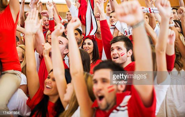 Group of ecstatic sport fans cheering.