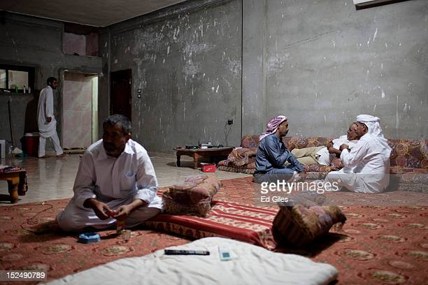 A group of Egyptian bedouin men sit inside a house during a meeting in the village of Al Mahdeya in Egypt's restive North Sinai region September 18...