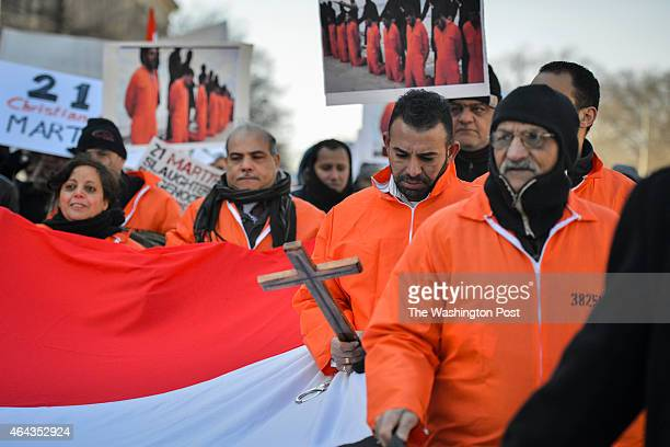 A group of Egyptian Coptic Christians including Amer Sabet holding a cross march from the White House toward the US Capitol in remembrance of 21...