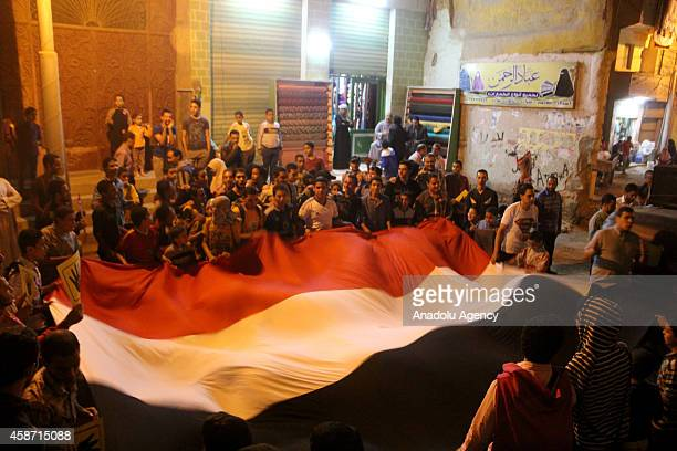 A group of Egyptian protestors hold Egyptian flag and shout slogans during an anticoup demonstration in Badrashin district of Giza Egypt on November...
