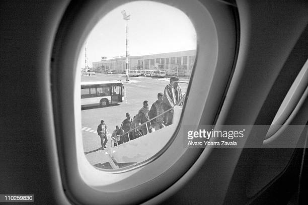 A group of Egyptian workers board a plane at the airport to be transferred back to Egypt on March 5 2011 in Djerba Tunisia As fighting continues in...