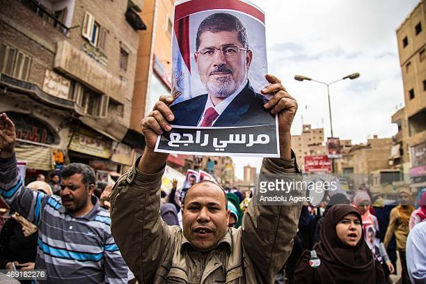 Group of Egyptians who call themselves as 'Anti-Coup demonstrators', hold former Egyptian President Mohamed Morsi's posters and banners as they stage...