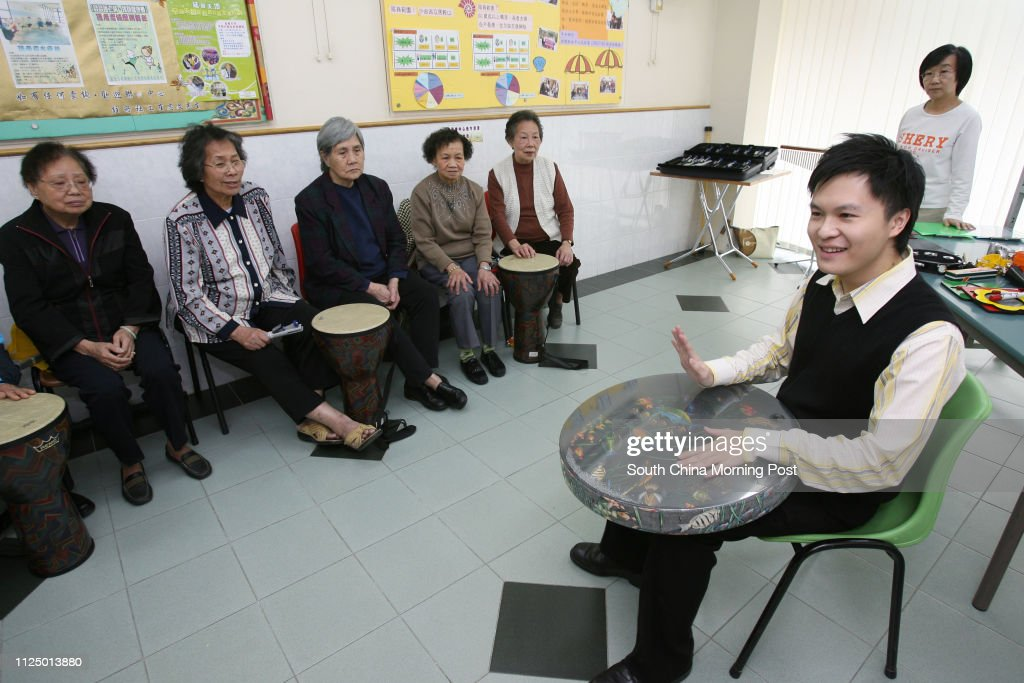 A group of elderly receive music therapy to treat their