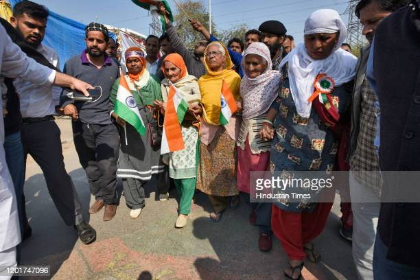Group of elderly women protesters approach towards police officers to seek permission to meet Home Minister Amit Shah, at Shaheen Bagh, on February...