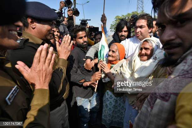 Group of elderly women protesters interact with police officers to seek permission for a meeting with Home Minister Amit Shah, at Shaheen Bagh, on...