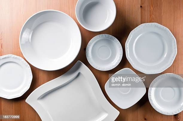 group of elegant china, everyday ceramics tableware on wooden table - ceramic stock photos and pictures