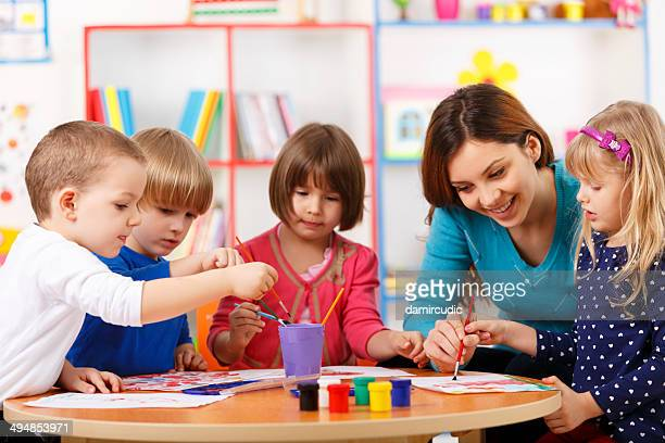 Group Of Elementary Age Children In Art Class With Teacher