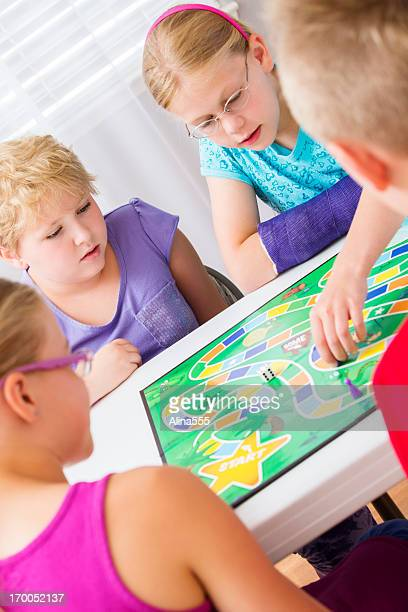 Group of elementary kids playing a board game