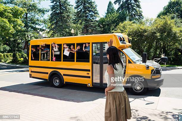 Group of elementary school kids in yellow school bus.