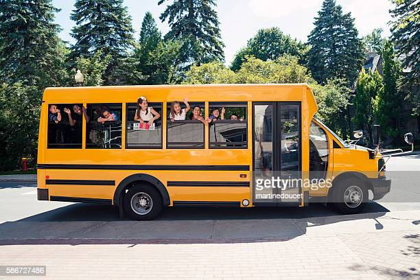 "group of elementary school kids in yellow school bus. - ""martine doucet"" or martinedoucet stock pictures, royalty-free photos & images"