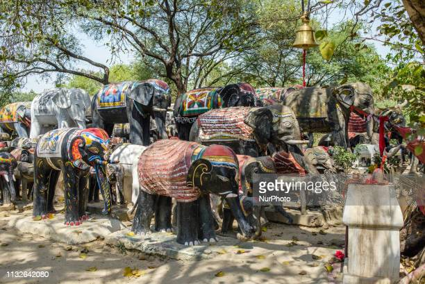 A group of elephant statues in front of a Hindu shrine near Lumbini Nepal on March 22 2019 Elephant statues are an offering of villagers to a Hindu...