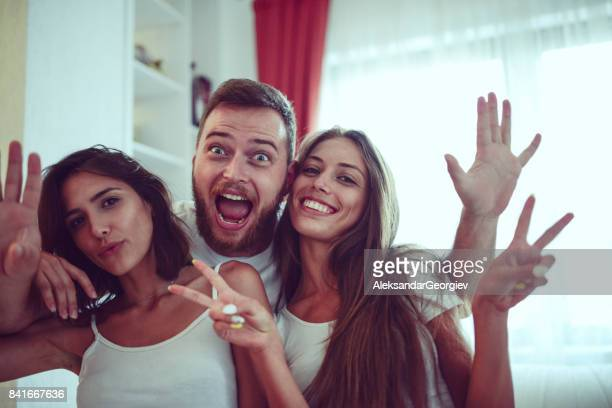 group of embraced friends make silly faces and posing at home - aleksandar georgiev stock photos and pictures