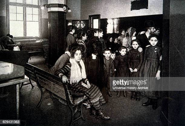 Group of Emigrants Waiting in the Detention Pen after Passing their Entrance Exam Ellis Island New York USA circa 1902