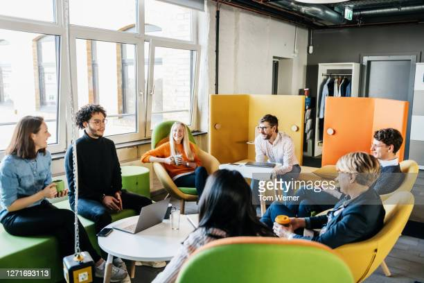 group of employees brainstorming during seminar - diversity stock pictures, royalty-free photos & images
