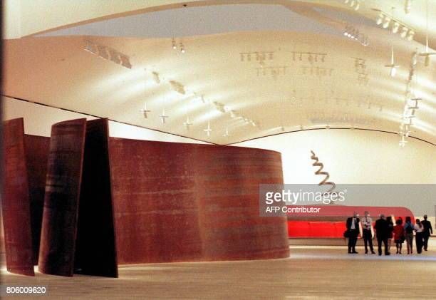 A group of employees of the Guggenheim museum in Bilbao 03 October take a preview walk in one of the exhibition halls of the recently finished...
