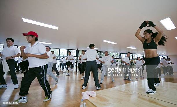 A group of employees of the local Finance Secretary exercise as part of a Mexico City's government program of exercises and diet to reduce obesity...