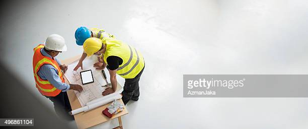 group of engineers and architects supervising construction - council flat stock pictures, royalty-free photos & images
