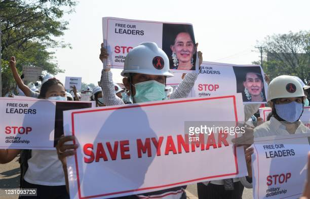 Group of engineers march on a road during a demonstration against the military coup in Naypyidaw on February 11, 2021.