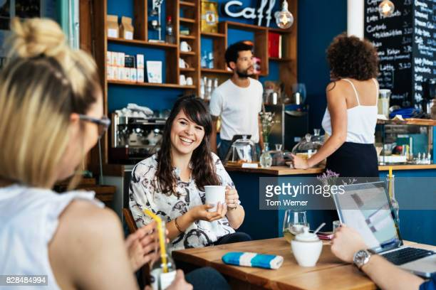 Group Of Entrepreneurs Having Meeting In Colourful Coffee Shop