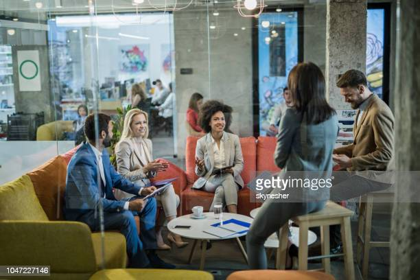 group of entrepreneurs having staff meeting at casual office. - staff meeting stock pictures, royalty-free photos & images