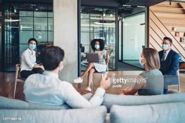 group of entrepreneurs on a meeting during the pandemic - coronavirus mask stock pictures, royalty-free photos & images
