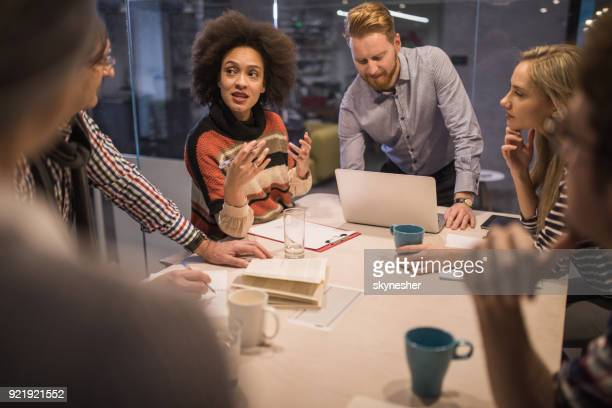 group of entrepreneurs talking about business strategy at casual office. - staff meeting stock pictures, royalty-free photos & images