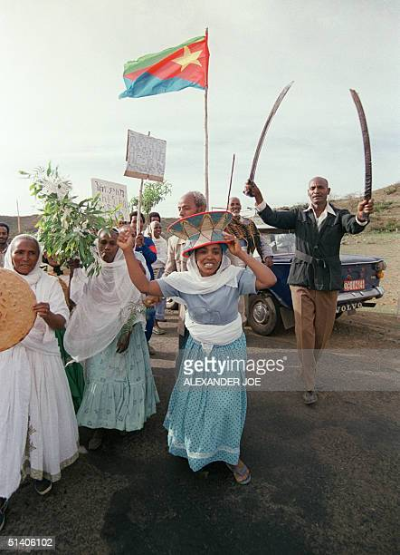 A group of Eritreans takes to the street singing and dancing 25 April 1993 in the Red Sea port of Massawa at the end of of a treeday referendum which...