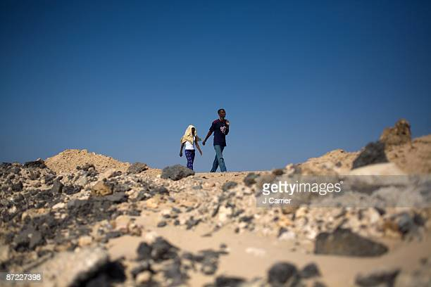 Group of Ethiopian refugees hike along the coastal highway towards the north of the country on November 10, 2008 in Ahwer, Yemen. Unlike Somalis,...