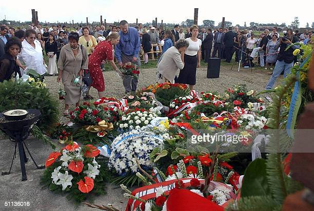 A group of European Gypsies lays flowers at Gypsies Death Monument in former Nazi death camp AuschwitzBirkenau to commemorate the 60th anniversary of...