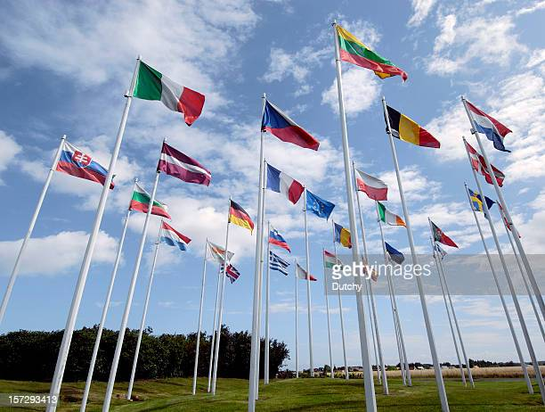 group of european union flags waving in the wind - international politics stock pictures, royalty-free photos & images