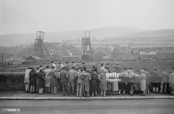 A group of evacuated school children from Clacton and FrintononSea gaze at the pit head workings of the Naval Colliery in the mining village of...