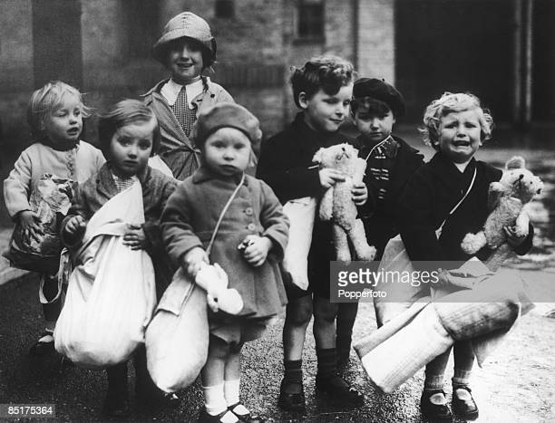 A group of evacuee children with their luggage and toys circa 1940