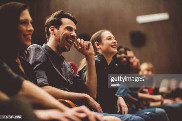 group of excited people in the movie theater - comedian stock pictures, royalty-free photos & images