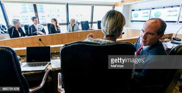 Group of executive people working on a conference room