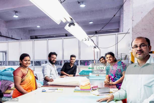 group of factory workers at the packaging area - maharashtra stock pictures, royalty-free photos & images