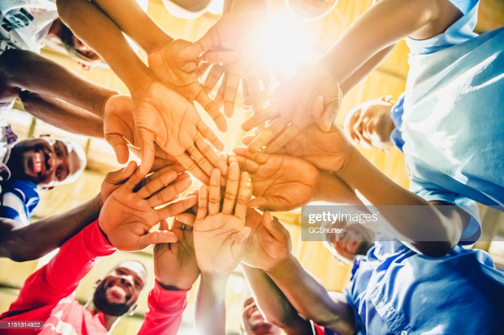 Group of Factory Workers Joining Hands to Express Unity : Stock Photo