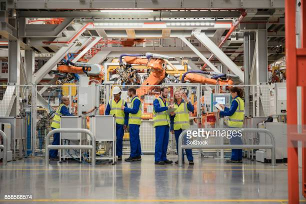 group of factory workers - manufacturing equipment stock pictures, royalty-free photos & images