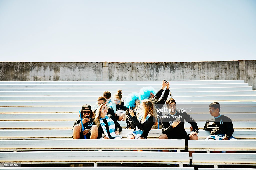 Group of fans in stadium before soccer match : Stock Photo
