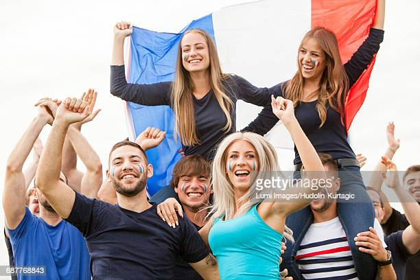 group of fans with french flag celebrating - french football photos et images de collection